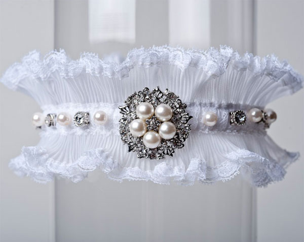 The wedding garter tradition is a fun one that is still seen at most
